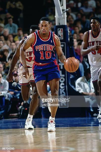 de1db358d Dennis Rodman of the Detroit Pistons brings the ball upcourt against the  New York Knicks circa