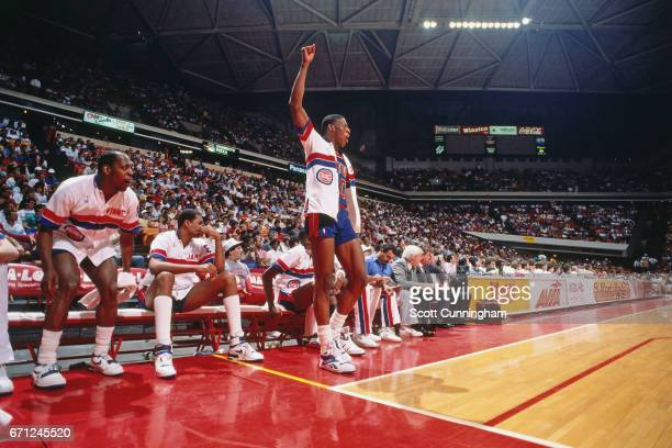 Dennis Rodman of the Detroit Pistons celebrates against the Atlanta Hawks during a game played circa 1990 at the Omni in Atlanta Georgia NOTE TO USER...