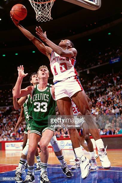 Dennis Rodman of the Detroit Pistons drives to the basket against the Boston Celtics during a game circa 1991 at The Palace of Auburn Hills in...