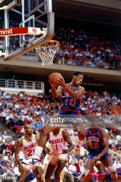 Dennis Rodman of the Detroit Pistons grabs a rebound against the Houston Rockets during a 1978 NBA game at the Summit in Houston, Texas. NOTE TO...