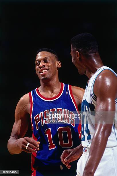 Dennis Rodman of the Detroit Pistons laughs against the Charlotte Hornets during a game played on March 22 1992 at the Charlotte Coliseum in...