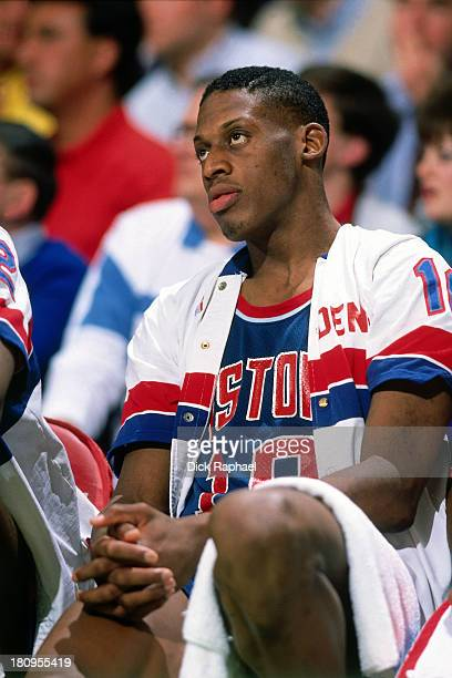 Dennis Rodman of the Detroit Pistons looks on against the Boston Celtics during a game played in 1988 at the Boston Garden in Boston Massachusetts...