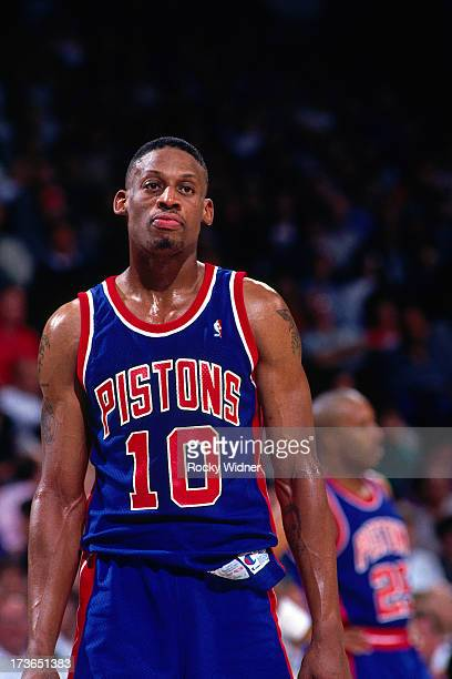 Dennis Rodman of the Detroit Pistons looks on against the Sacramento Kings during a game played on March 16 1993 at Arco Arena in Sacramento...
