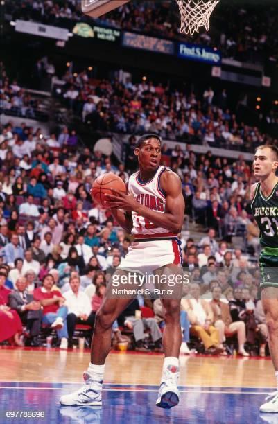 Dennis Rodman of the Detroit Pistons looks to pass against the Milwaukee Bucks circa 1990 at the Palace of Auburn Hills in Auburn HIlls Michigan NOTE...