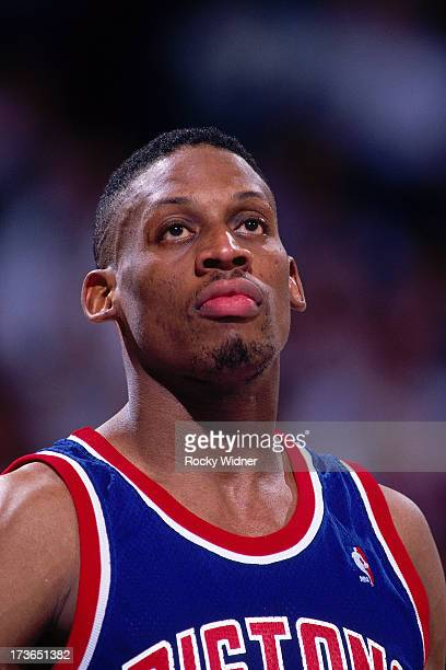 Dennis Rodman of the Detroit Pistons looks up to the scoreboard during a game against the Sacramento Kings played on March 16 1993 at Arco Arena in...