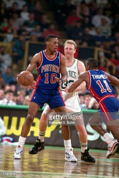 Dennis Rodman of the Detroit Pistons posts up against Larry Bird of the Boston Celtics during the 1991 NBA game at The Boston Garden in Boston...