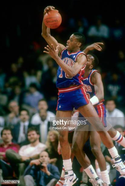 Dennis Rodman of the Detroit Pistons pulls down a rebound against the Washington Bullets circa 1988 during an NBA basketball game at the Capital...