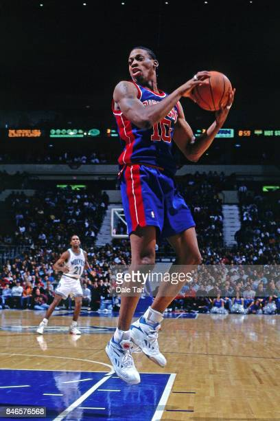 Dennis Rodman of the Detroit Pistons rebounds against the Minnesota Timberwolves circa 1993 at the Target Center in Minneapolis Minnesota NOTE TO...