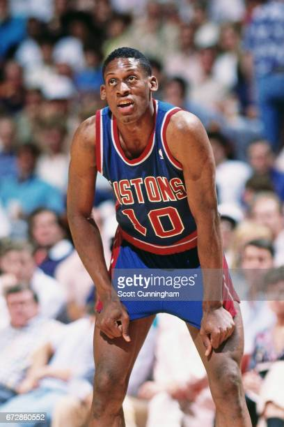 Dennis Rodman of the Detroit Pistons rests against the Atlanta Hawks during a game played circa 1990 at the Omni in Atlanta Georgia NOTE TO USER User...