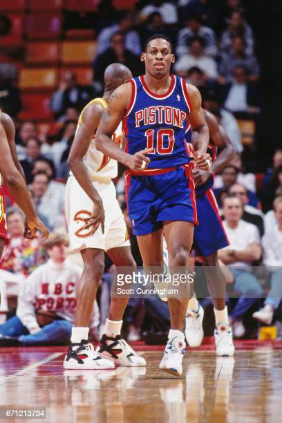 Dennis Rodman of the Detroit Pistons runs against the Atlanta Hawks during a game played circa 1990 at the Omni in Atlanta Georgia NOTE TO USER User...