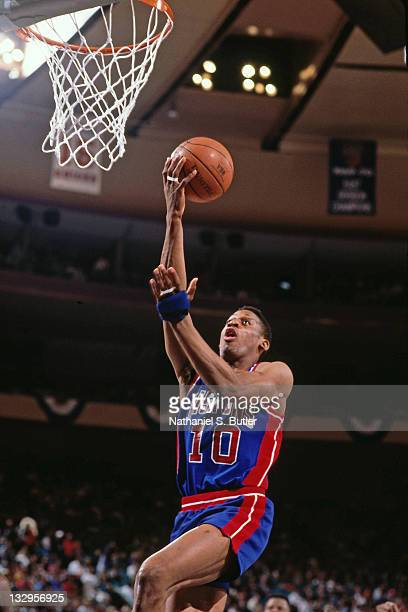 Dennis Rodman of the Detroit Pistons shoots against the New York Knicks circa 1991 at Madison Square Garden in New York NOTE TO USER User expressly...