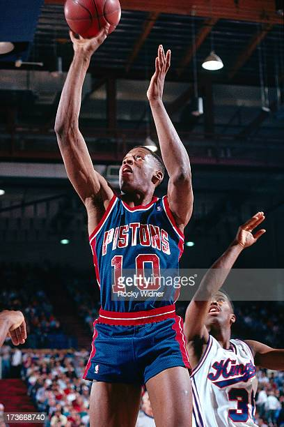 Dennis Rodman of the Detroit Pistons shoots against the Sacramento Kings during a game played on February 23 1988 at Arco Arena in Sacramento...
