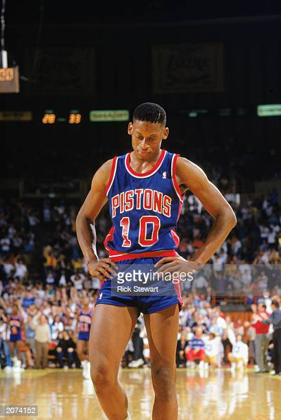 Dennis Rodman of the Detroit Pistons walks on the court during a game against the Los Angeles Lakers at the Great Western Forum in Los Angeles...