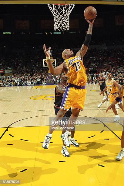 Dennis Rodman of the Los Angeles Lakers makes a rebound during a National Basketball Association game against the Denver Nuggets at the Great Western...