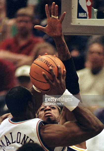 Dennis Rodman of the Los Angeles Lakers tries to block a shot by Karl Malones of the Utah Jazz during NBA action 07 March in Salt Lake City Utah AFP...