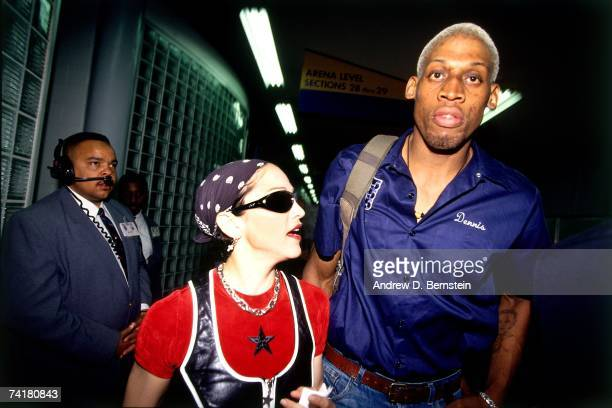 Dennis Rodman of the San Antonio Spurs and Madonna strolls through the arena before a 1994 NBA game. NOTE TO USER: User expressly acknowledges that,...