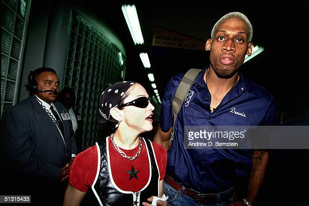 Dennis Rodman of the San Antonio Spurs is seen leaving the arena with Madonna after playing an NBA game against the Los Angeles Clippers at The Los...