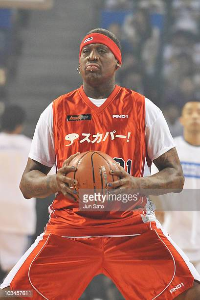 "Dennis Rodman performs during the ""Street2Elite"" street basketball event at Ariake Colosseum on August 19, 2010 in Tokyo, Japan."