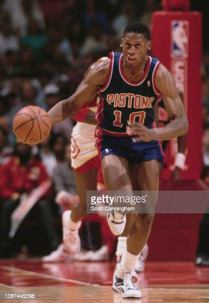Dennis Rodman, Power Forward for the Detroit Pistons dribbles the basketball up court during the NBA Central Division basketball game against the...