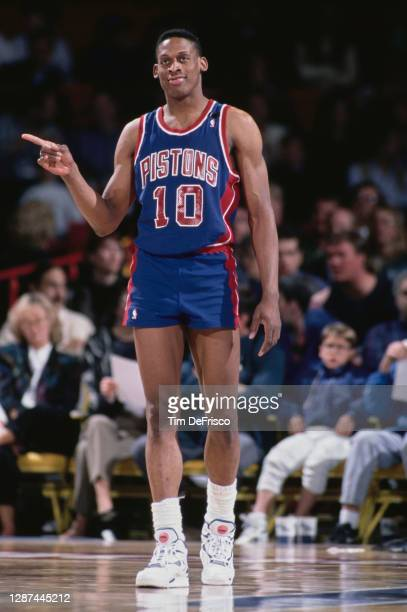 Dennis Rodman, Power Forward for the Detroit Pistons during the NBA Midwest Division basketball game against the Denver Nuggets on 25th March 1991 at...
