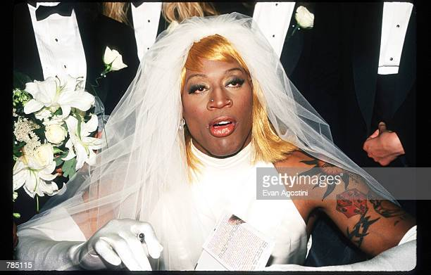 Dennis Rodman signs his autobiography August 21 1996 in New York City Rodman arrived in a horsedrawn carriage dressed in a wedding gown to launch his...