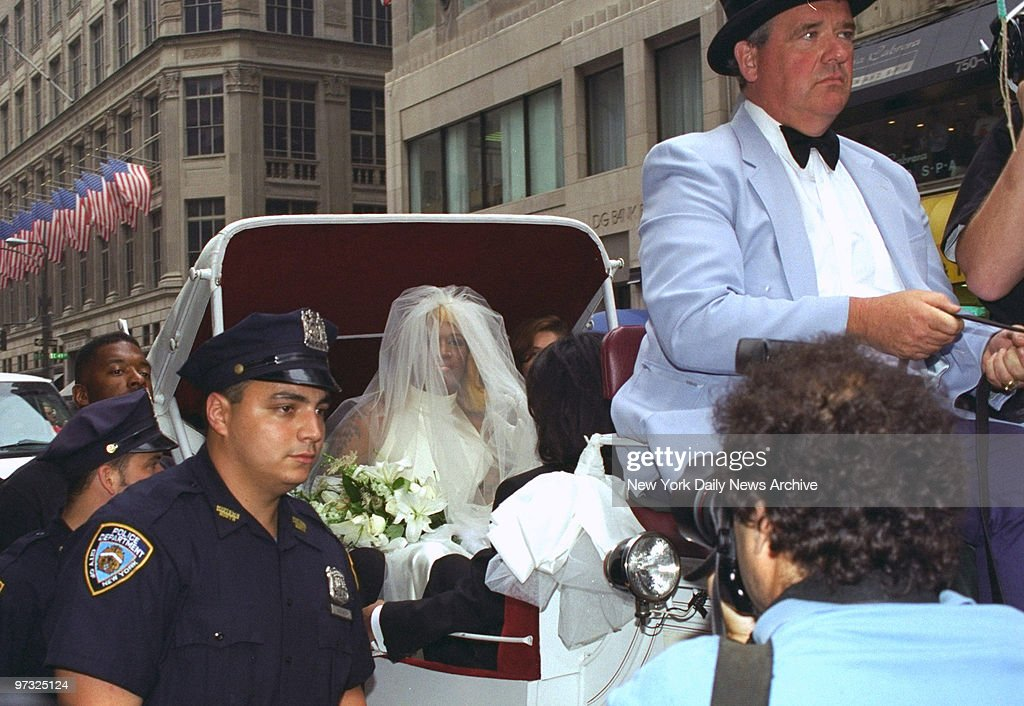 Dennis Rodman, wearing a wedding gown, arrives at his book s ...