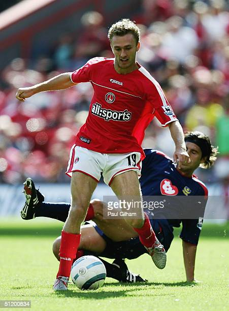 Dennis Rommedahl of Charlton Athletic evades a challenge from Dejan Stefanovic of Portsmouth during the Barclays Premiership match between Charlton...