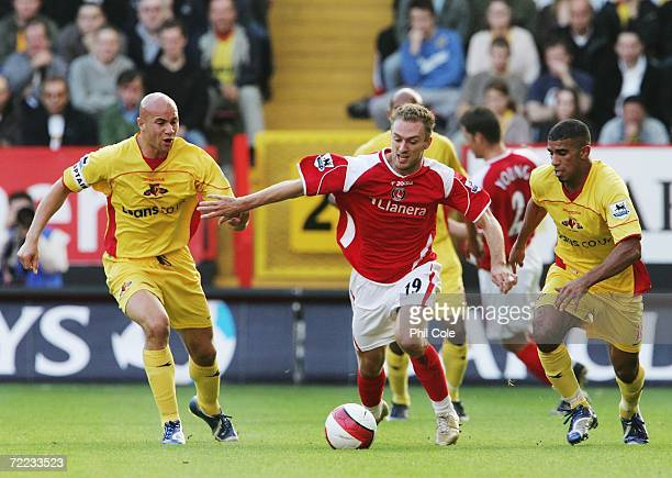 Dennis Rommedahl of Charlton Athletic shields the ball from Hameur Bouazza and Gavin Mahon of Watford during the Barclays Premiership match between...