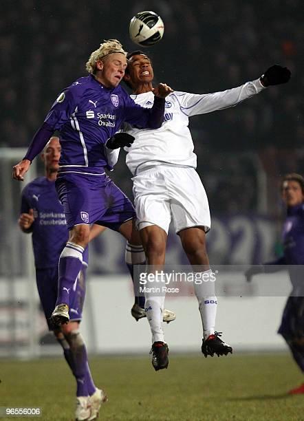Dennis Schmidt of Osnabruck and Joel Matip of Schalke jump to head for the ball during the DFB Cup quarter final match between VfL Osnabrueck and FC...