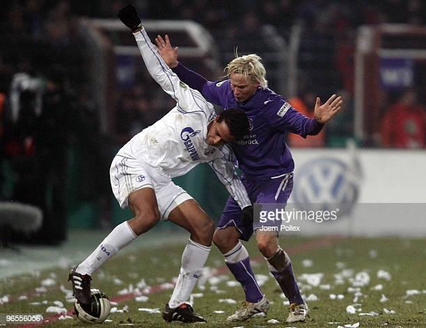 Dennis Schmidt of Osnabrueck and Joel Matip of Schalke battle for the ball during the DFB Cup quarter final match between VfL Osnabrueck and FC...