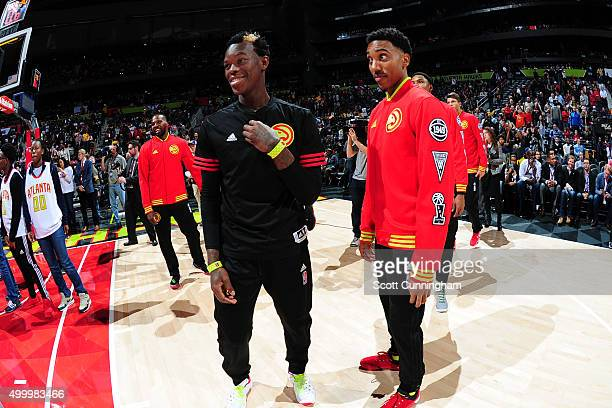 Dennis Schroder and Jeff Teague of the Atlanta Hawks looks on before the game against the Los Angeles Lakers on December 4 2015 at Philips Arena in...