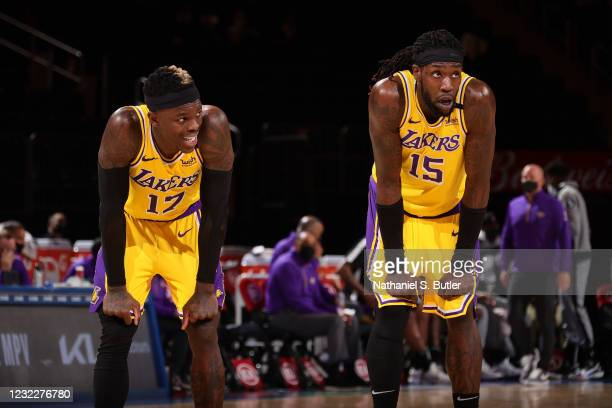 Dennis Schroder and Montrezl Harrell of the Los Angeles Lakers look on during the game against the New York Knicks on April 12, 2021 at Madison...