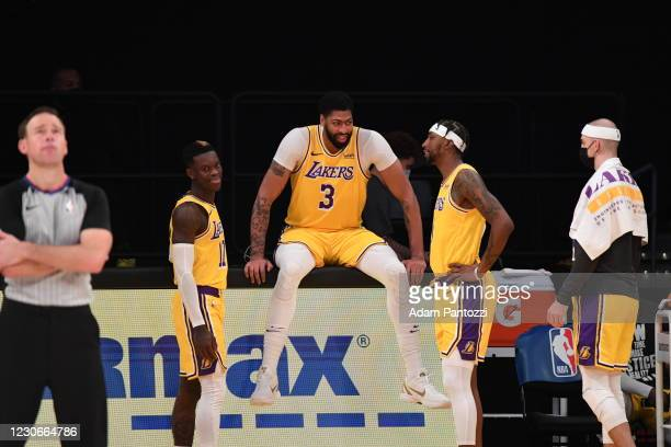 Dennis Schroder, Anthony Davis, and Kentavious Caldwell-Pope of the Los Angeles Lakers talk during the game against the Golden State Warriors on...