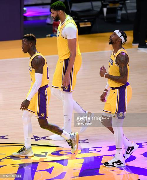 Dennis Schroder, Anthony Davis and Kentavious Caldwell-Pope of the Los Angeles Lakers react as they leave the floor trailing the Golden State...
