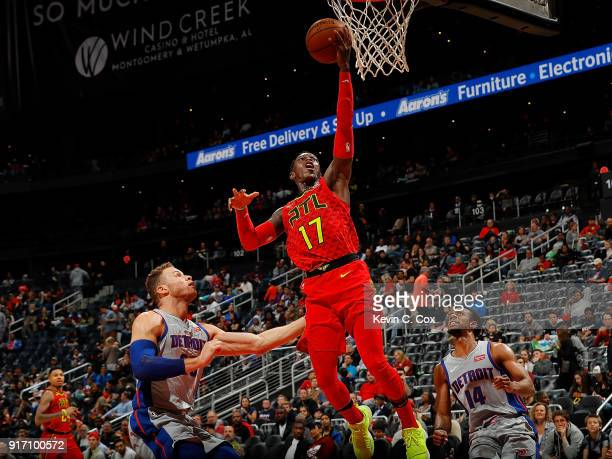 Dennis Schroder of the Atlanta Hawks attacks the basket against Blake Griffin and Ish Smith of the Detroit Pistons at Philips Arena on February 11...