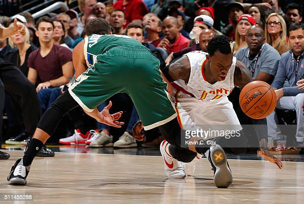 Dennis Schroder of the Atlanta Hawks battles for a loose ball against Michael CarterWilliams of the Milwaukee Bucks at Philips Arena on February 20...