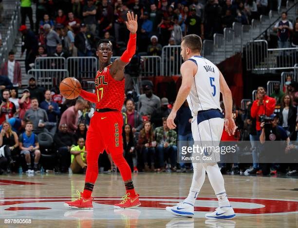 Dennis Schroder of the Atlanta Hawks calls a play in the final seconds against JJ Barea of the Dallas Mavericks at Philips Arena on December 23 2017...