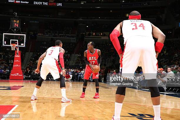 Dennis Schroder of the Atlanta Hawks defends the ball against the Washington Wizards during the game on April 12 2015 at Verizon Center in Washington...