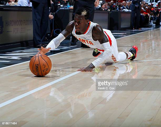 Dennis Schroder of the Atlanta Hawks dives for a loose ball against the Washington Wizards at Philips Arena on October 27 2016 in Atlanta Georgia...