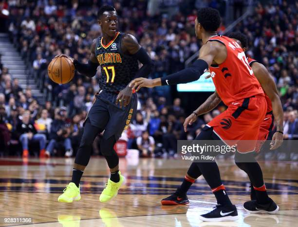 Dennis Schroder of the Atlanta Hawks dribbles the ball as Malcolm Miller of the Toronto Raptors defends during the second half of an NBA game at Air...