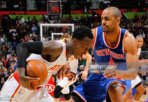 Dennis Schroder of the Atlanta Hawks drives against Arron Afflalo of the New York Knicks at Philips Arena on January 5 2016 in Atlanta Georgia NOTE...