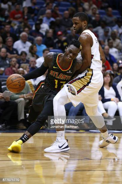 Dennis Schroder of the Atlanta Hawks drives against Darius Miller of the New Orleans Pelicans during the first half of a game at the Smoothie King...
