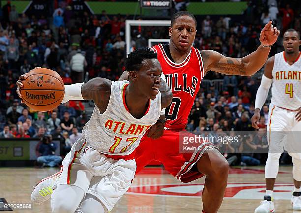 Dennis Schroder of the Atlanta Hawks drives against Isaiah Canaan of the Chicago Bulls at Philips Arena on November 9 2016 in Atlanta Georgia NOTE TO...