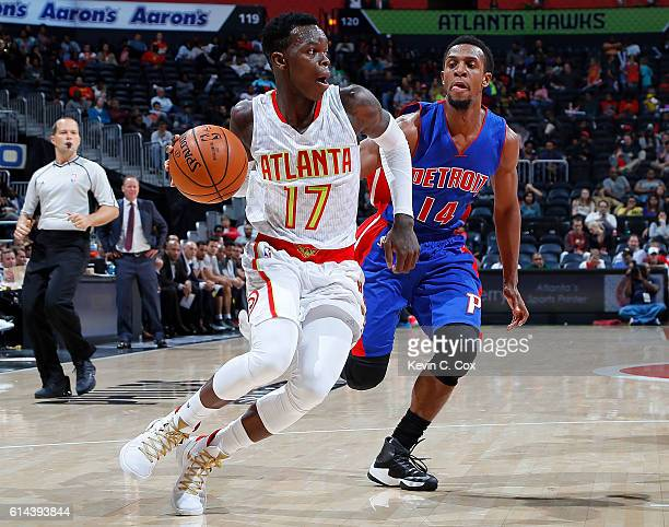 Dennis Schroder of the Atlanta Hawks drives against Ish Smith of the Detroit Pistons at Philips Arena on October 13 2016 in Atlanta Georgia NOTE TO...