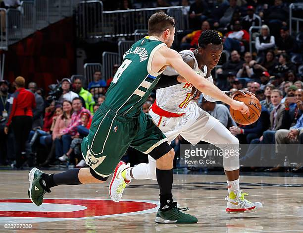 Dennis Schroder of the Atlanta Hawks drives against Matthew Dellavedova of the Milwaukee Bucks at Philips Arena on November 16 2016 in Atlanta...