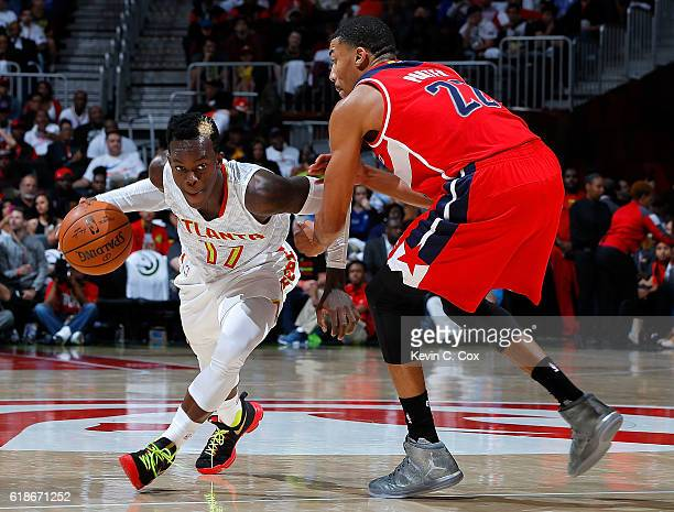 Dennis Schroder of the Atlanta Hawks drives against Otto Porter Jr #22 of the Washington Wizards at Philips Arena on October 27 2016 in Atlanta...