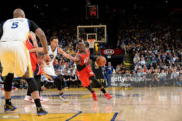 Dennis Schroder of the Atlanta Hawks drives against the Golden State Warriors on March 18 2015 at Oracle Arena in Oakland California NOTE TO USER...