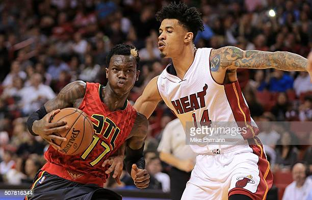 Dennis Schroder of the Atlanta Hawks drives on Gerald Green of the Miami Heat during a game at American Airlines Arena on January 31 2016 in Miami...