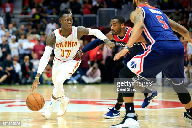 Dennis Schroder of the Atlanta Hawks drives to the basket against John Wall of the Washington Wizards during the fourth quarter in Game Four of the...