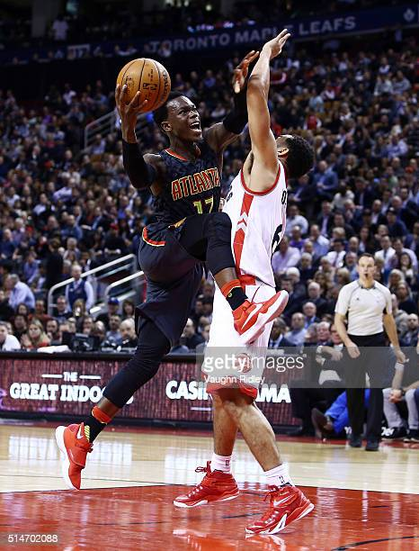 Dennis Schroder of the Atlanta Hawks drives to the basket as Cory Joseph of the Toronto Raptors defends during the second half of an NBA game at the...